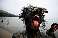 "Bloco da Lama in Paraty, Rio de Janeiro State, Brazil. Clad in swimwear and rags, slathered in mud, adorned with branches and bones and crying ""ooga ooga ha ha"", revelers parade through the streets of Paraty's colonial district every Carnival Saturday afternoon."