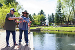 Patty Daub learns to fly fish with her River Buddy Betsy Clark during the Casting for Recovery fishing clinic at Bently Ranch in Gardnerville, Nev. May 4, 2018.<br /> Photo by Candice Vivien/Nevada Momentum