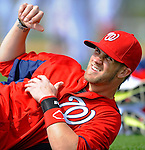 25 February 2012: Washington Nationals' outfielder Bryce Harper stretches out during the first full squad Spring Training workout at the Carl Barger Baseball Complex in Viera, Florida. Mandatory Credit: Ed Wolfstein Photo