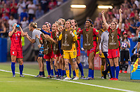 LYON,  - JULY 2: Ashlyn Harris #18 celebrates with Morgan Brian #6 and other teammates during a game between England and USWNT at Stade de Lyon on July 2, 2019 in Lyon, France.