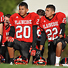 Plainedge No. 20 Oscar Jimenez, left, and brother No. 22 David Jimenez take a knee in the post-game huddle following their team's 38-0 win over Lawrence in a Nassau County Conference III varsity football game played at Plainedge High School on Saturday, October 17, 2015.<br /> <br /> James Escher