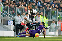 2nd February 2020; Allianz Stadium, Turin, Italy; Serie A Football, Juventus versus Fiorentina; Douglas Costa of Juventus skips the tackle from Dalbert of Fiorentina