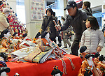 """February 17, 2013, Konosu, Japan - Visitors take a closer look at Girls' Fewstival ornamental dolls displayed on the red-carpeted platform in a huge pyramid shaped at the lobby of Konosu city hall, north of Tokyo, on Sunday, February 17, 2013. The dolls numbered 18,000 represent emperor, empress, attendants and musicians in the ancient Imperial court. The city of Konosu, situated some 40 km north of Tokyo, is known as """" the doll town"""" for a number of factories manufacturing Japanese dolls. Japanese tradition calls upon families with daughters for putting out dolls for the Girls Day on March 3 with the hopes that they grow up healthy and happily. (Photo by Natsuki Sakai/AFLO) AYF -mis-."""