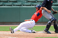 GCL Red Sox outfielder Bryan Hudson (43) slides into home safely during a game against the GCL Twins on July 19, 2013 at JetBlue Park at Fenway South in Fort Myers, Florida.  GCL Red Sox defeated the GCL Twins 4-2.  (Mike Janes/Four Seam Images)