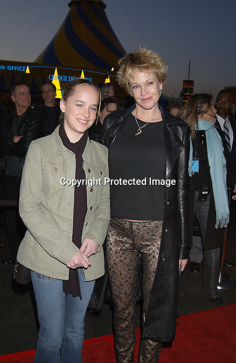 MELANIE GRIFFITH & DAUGHTER DAKOTAH                     . AT THE OPENING OF CIRQUE DU SOLEIL VAREKAI ON RANDALL'S ISLAND ON APRIL 24,2003..PHOTO BY ROBIN PLATZER, TWIN IMAGES
