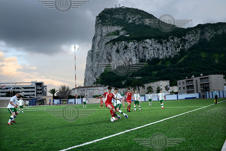 The Rock of Gibraltar is the backdrop for an under-17 football match against Northern Ireland at the Victoria Stadium. Although the United Nations doesn't recognise Gibraltar as an independent country, UEFA has recognised it and has granted the British Overseas Territory full UEFA membership.