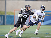 Washington, DC - April 7, 2018: Providence Friars Sean Leahey (30) holds off a Georgetown Hoyas defender during game between Providence and Georgetown at  Cooper Field in Washington, DC.   (Photo by Elliott Brown/Media Images International)