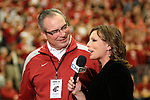 Bill Moos does a halftime interview with Jen Mueller of FSN (Fox Sports Northwest) at the WSU vs. UW basketball game at Friel Court in Pullman, Washington, on February 27, 2010.