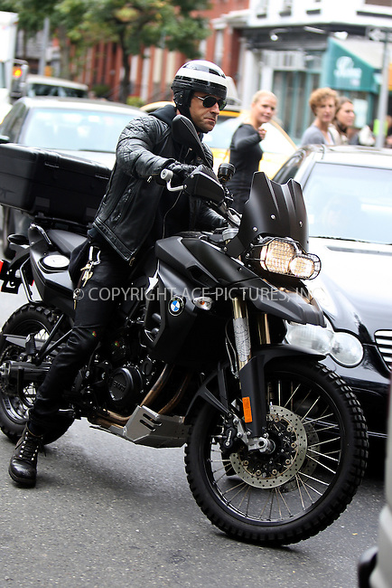 WWW.ACEPIXS.COM . . . . .  ....September 17 2011, New York City....Actor Justin Theroux arriving at Jennifer Aniston's apartmet on his BMW motorcycle on September 17 2011 in New York City....Please byline: PHILIP VAUGHAN - ACE PICTURES.... *** ***..Ace Pictures, Inc:  ..Philip Vaughan (212) 243-8787 or (646) 679 0430..e-mail: info@acepixs.com..web: http://www.acepixs.com