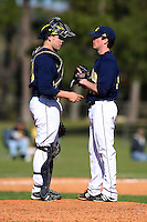 February 28, 2010:  Pitcher Tyler Burgoon (24) and Catcher Chris Berset (10) meet on the mound during the Big East/Big 10 Challenge at Raymond Naimoli Complex in St. Petersburg, FL.  Photo By Mike Janes/Four Seam Images
