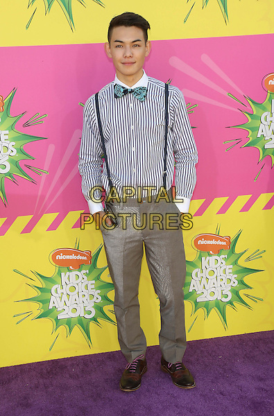 Ryan Potter.at The Nickelodeon's Kids' Choice Awards 2013 held at The Galen Center in Los Angeles, California, USA,.March 23rd 2013.full length blue white stripe shirt bow tie hands in pockets suspenders braces trousers hands in pockets  .CAP/ADM/KB.©Kevan Brooks/AdMedia/Capital Pictures.