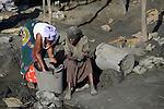 TANZANIA Geita, artisanal gold mining in Mgusu, where about 4000 people mine, crush and wash under hazardous conditions like no safety underground, horrible noise, toxic dust, use of mercury, the effluents are dumped untreated and uncontrolled and pollute the environment  / TANSANIA Geita, kleine Goldminen in Mgusu, ca. 4000 Menschen foerdern Golderz aus kleinen Schaechten, zermalmen das Erz zu Staub und waschen Goldstaub mit Quecksilber aus, die Abwaesser werden unkontrolliert in die Umwelt geleitet