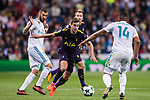 Harry Winks of Tottenham Hotspur FC (C) fights for the ball with Karim Benzema of Real Madrid (L), and Carlos Henrique Casemiro of Real Madrid (R) during the UEFA Champions League 2017-18 match between Real Madrid and Tottenham Hotspur FC at Estadio Santiago Bernabeu on 17 October 2017 in Madrid, Spain. Photo by Diego Gonzalez / Power Sport Images