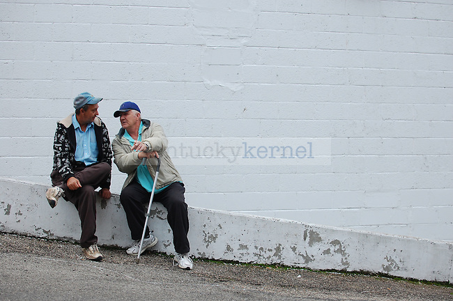 """Roy Genkinn, left, 49, and his brother-in-law Wardie Fugate, 63, chatted on a ledge off of Main Street in Jackson, Ky. on Thursday Oct. 13, 2011. """"It's a nice place here,"""" Fugate said. """"I've been to a lot of other places but there's just nowhere like here,"""" said Fugate. Photo by Brooke DiDonato"""