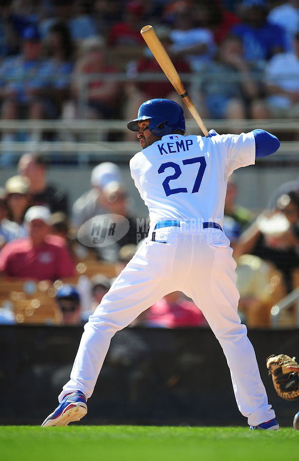 Mar. 16, 2012; Phoenix, AZ, USA; Los Angeles Dodgers outfielder Matt Kemp bats in the fifth inning against the Texas Rangers at The Ballpark at Camelback Ranch. Mandatory Credit: Mark J. Rebilas-