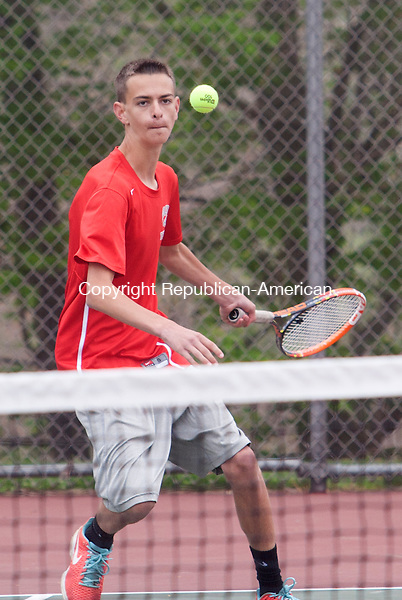 WOLCOTT, CT - 09 APRIL 2015 - 050915JW05.jpg -- Matt Mastropietro of Wolcott of returns against PJ Morrissey of Naugatuck during NVL match at Wolcott Saturday morning. Jonathan Wilcox Republican-American