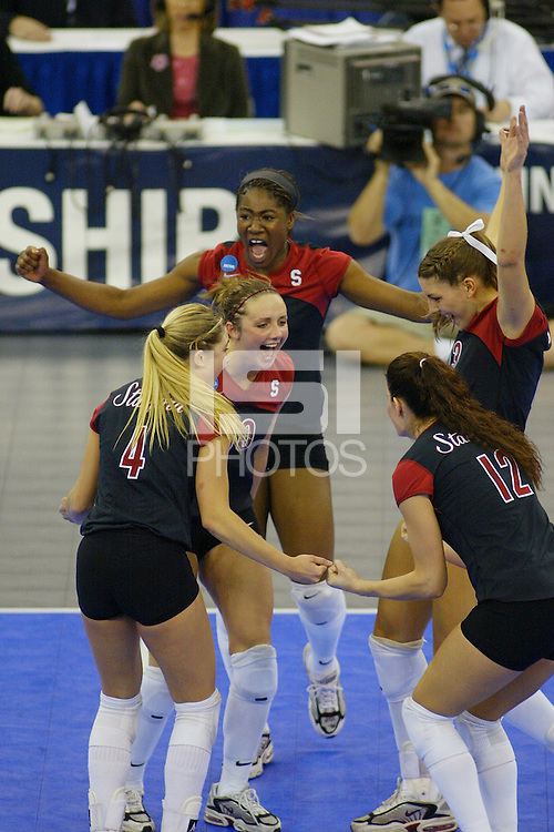 18 December 2004: Stanford Cardinal Kristin Richards celebrates with Jennifer Hucke, Bryn Kehoe, Liz Suiter, and Ogonna Nnamani during Stanford's  30-23, 30-27, 30-21 victory over Minnesota in the 2004 NCAA Women's Volleyball National Championships in Long Beach, CA. Stanford won their sixth women's volleyball title in school history.<br />