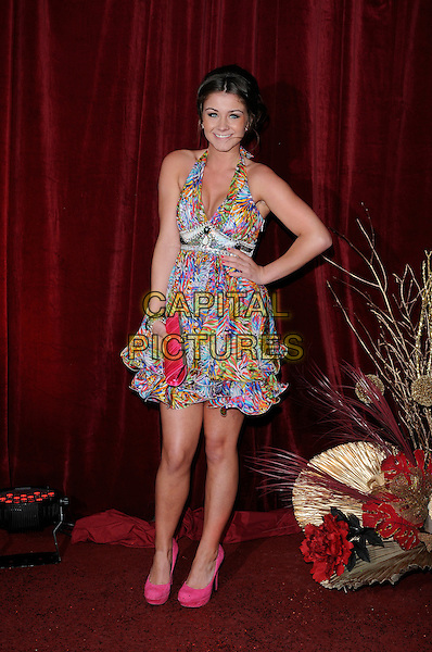 BROOKE VINCENT .wearing Lipsy dress.Attending The British Soap Awards 2010, The London Television Centre, London, England, UK, 8th May 2010 .arrivals full length pink blue multi-coloured halterneck shoes platform heels clutch bag ruffle hem tiered hand on hip .CAP/CAN.©Can Nguyen/Capital Pictures.