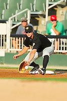 West Virginia Power first baseman Walker Gourley (5) stretches for a throw during the South Atlantic League game against the Kannapolis Intimidators at CMC-Northeast Stadium on July 9, 2013 in Kannapolis, North Carolina.  The Power defeated the Intimidators 3-1.   (Brian Westerholt/Four Seam Images)