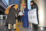March 22, 2011, Kawasaki City, Kanagawa Prefecture, Japan - Sumo wrestlers pitch in to gather donations for earthquake, tsunami and fire survivors of the 2011 Tohoku-Kanto Natural Disaster in front of Mizonokuchi Station in Kawasaki, Kanagawa Prefecture, Japan.  (Photo by Atsushi Tomura/AFLO)