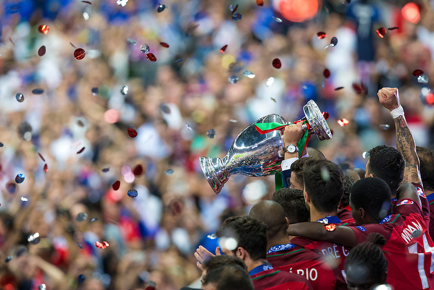 Portugal players celebrate by lifting the winners trophy<br /> <br /> Photographer Craig Mercer/CameraSport<br /> <br /> International Football - 2016 UEFA European Championship - Final - Portugal v France - Sunday 10th July 2016 - Stade de France - Saint-Denis - Paris - France<br /> <br /> World Copyright &copy; 2016 CameraSport. All rights reserved. 43 Linden Ave. Countesthorpe. Leicester. England. LE8 5PG - Tel: +44 (0) 116 277 4147 - admin@camerasport.com - www.camerasport.com