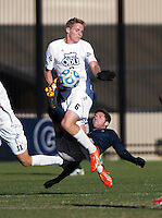 Tyler Rudy (13) of Georgetown kicks the ball away from Ryan Condotta (6) of Old Dominion during the second round of the NCAA tournament at Shaw Field in Washington, DC. Georgeotown defeated Old Dominion, 3-0.