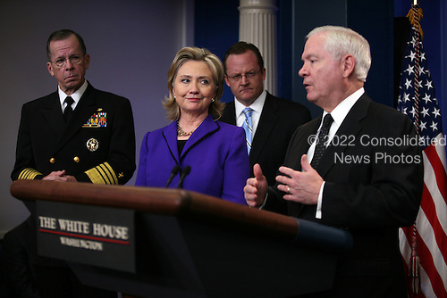 "United States Secretary of State Hillary Rodham Clinton, Chairman of the Joint Chiefs of Staff Admiral Mike Mullen (left), and White House Press Secretary Robert Gibbs look on as U.S. Secretary of Defense Robert Gates briefs the media on Friday, March 26, 2010 at the White House following U.S. President Barack Obama's phone call with President Dmitry Medvedev of Russia in which the two leaders agreed to sign the  ""New START Treaty"" in Prague, Czech Republic on April 8, 2010..Credit: Martin H. Simon - Pool via CNP"
