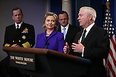 """United States Secretary of State Hillary Rodham Clinton, Chairman of the Joint Chiefs of Staff Admiral Mike Mullen (left), and White House Press Secretary Robert Gibbs look on as U.S. Secretary of Defense Robert Gates briefs the media on Friday, March 26, 2010 at the White House following U.S. President Barack Obama's phone call with President Dmitry Medvedev of Russia in which the two leaders agreed to sign the  """"New START Treaty"""" in Prague, Czech Republic on April 8, 2010..Credit: Martin H. Simon - Pool via CNP"""