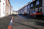 Road edging painted in the colours of the Union Jack flag painted by the Protestant community in Belfast, Northern Ireland.