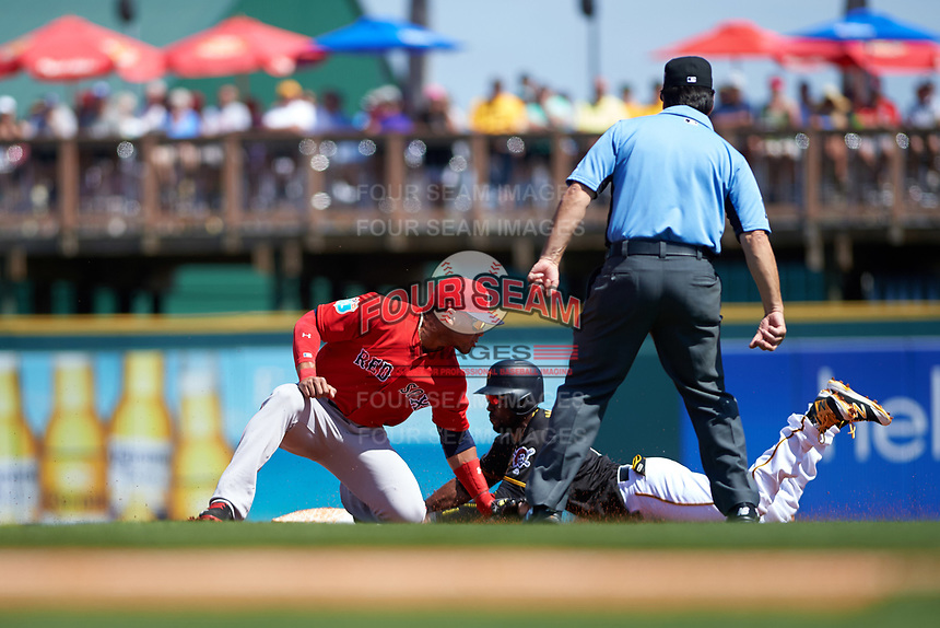 Boston Red Sox second baseman Yoan Moncada (22) looks to tag Starling Marte (6) sliding in during a Spring Training game against the Pittsburgh Pirates on March 9, 2016 at McKechnie Field in Bradenton, Florida.  Boston defeated Pittsburgh 6-2.  (Mike Janes/Four Seam Images)