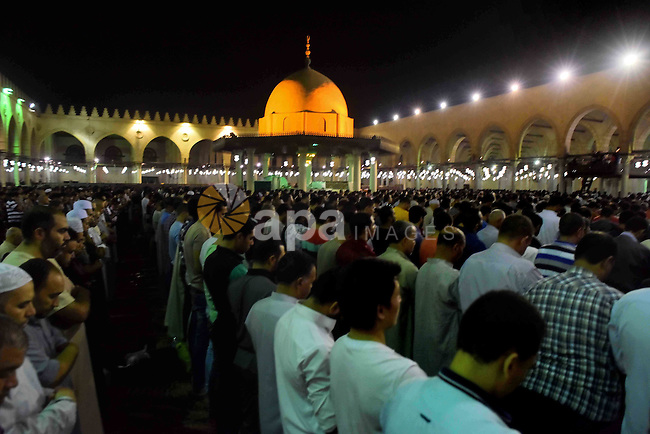 Egyptian muslim worshipers take part in Laylat Al Qadr prayers or Night of Power, in which the Muslim holy book of Koran was revealed to Prophet Mohammad by Allah on the 27th day of the holy fasting month of Ramadan at Amr Bin al-Aas mosque in Cairo during Ramadan July 2, 2016. Photo by Amr Sayed