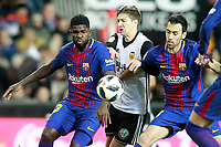 Valencia CF's Luciano Vietto (c) and FC Barcelona's Samuel Umtiti (l) and Sergio Busquets during Spanish King's Cup Semi Final 2nd match. February 8,2018.  *** Local Caption *** © pixathlon<br /> Contact: +49-40-22 63 02 60 , info@pixathlon.de
