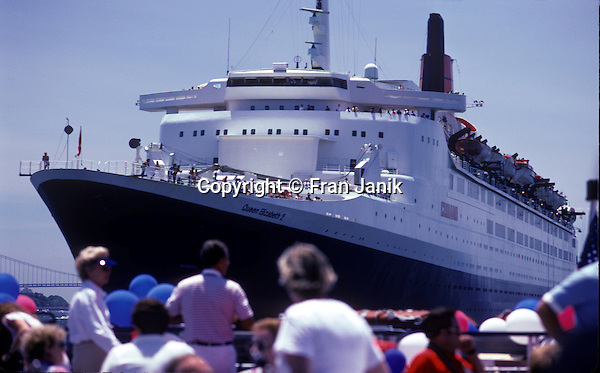 The QE2 is photographed from a smaller motor yacht during the 200th birthday celebration for the Statue of Liberty in New York City 0n July 5th in 1986. The Verrazano-Narrows Bridge is seen in the backround