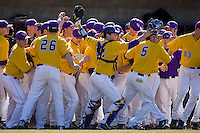 The East Carolina Pirates take the field to start their game against the Virginia Cavaliers at Clark-LeClair Stadium on February 20, 2010 in Greenville, North Carolina.   Photo by Brian Westerholt / Four Seam Images