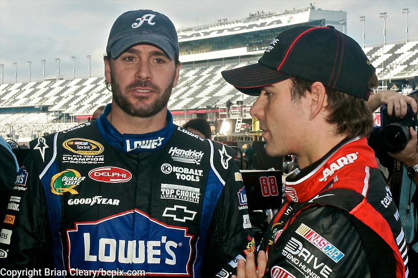 Five-time NASCAR champion Jimmie Johnson, left, talks with four-time champ Jeff Gordon in the garage at Daytona during winter testing, January 20, 2011.  (Photo by Brian Cleary/www.bcpix.com)