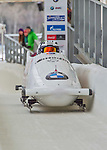9 January 2016: Canadian pilot Kaillie Humphries leads her 4-man team as they cross the finish line after their second run of the day at the BMW IBSF World Cup Bobsled Championships at the Olympic Sports Track in Lake Placid, New York, USA. Humphries' team came in 17th for the day, with a 2-run combined time of 1:54.47. Mandatory Credit: Ed Wolfstein Photo *** RAW (NEF) Image File Available ***