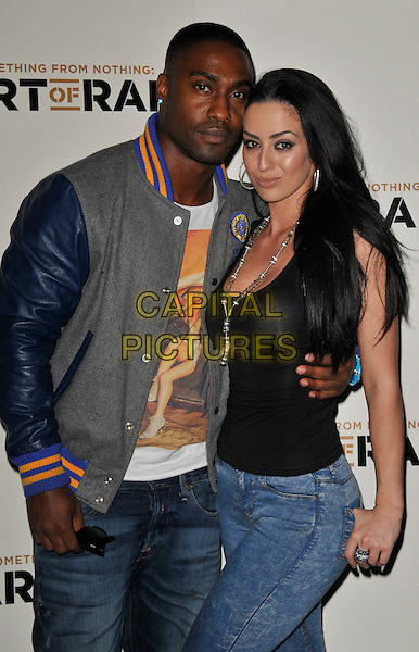 Simon Webbe and Maria Koukas .'Something For Nothing: The Art of Rap' European premiere arrivals, Hammersmith Apollo, London, England. 19th July 2012..half length grey gray blue baseball jacket jeans couple arm around .CAP/WIZ.© Wizard/Capital Pictures.