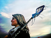 High School Lacrosse player and volunteer coach at a lacrosse clinic and practice at a city park in Westerville, OH.