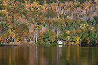 Seclude house on Echo Lake with autumn foilage, Vermont, USA