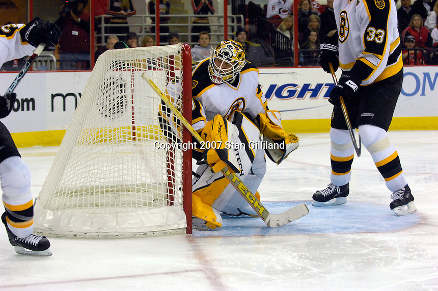 Boston Bruins' goalie Tim Thomas watches the action behind the net during a game against the Carolina Hurricanes Saturday, Feb. 3, 2007 at the RBC Center in Raleigh. Boston won 4-3 in overtime.