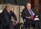 Former United States Senator Bob Dole (Republican of Kansas), right, makes remarks accepting the Congressional Gold Medal as US President Donald J. Trump, left, listens at a ceremony in his honor in the Rotunda of the US Capitol on Wednesday, January 17, 2017.  Congress commissioned gold medals as its highest expression of national appreciation for distinguished achievements and contributions.  Dole served in Congress from 1961 through 1996, was the Senate GOP leader from 1985 through 1996, and was the 1996 Republican Party nominee for President of the United States.<br /> Credit: Ron Sachs / CNP