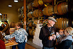 Steve Marshall talks to Morgen Marshall and her son Xander in the tasting room and barrel room at the Claiborne and Churchill Winery in San Luis Obispo, California December 20, 2014.