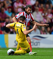 Lincoln City's Michael Bostwick is fouled by Morecambe's Alex Kenyon<br /> <br /> Photographer Chris Vaughan/CameraSport<br /> <br /> The EFL Sky Bet League Two - Lincoln City v Morecambe - Saturday August 12th 2017 - Sincil Bank - Lincoln<br /> <br /> World Copyright &copy; 2017 CameraSport. All rights reserved. 43 Linden Ave. Countesthorpe. Leicester. England. LE8 5PG - Tel: +44 (0) 116 277 4147 - admin@camerasport.com - www.camerasport.com