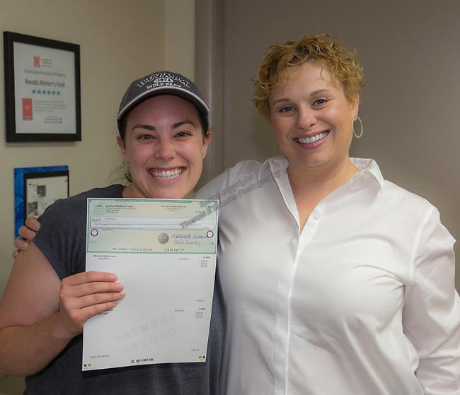 Anna Pelino, left, and Board Member Alexia Bratiotis Jobson during the Nevada Women's Fund Scholarship distribution, June 20, 2019.