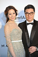HONG KONG - MARCH 14:  Model and Actress Cathy Tsui Lee (L) and Martin Lee arrive on the red carpet during the 2015 amfAR Hong Kong gala at Shaw Studios on March 14, 2015 in Hong Kong. Photo : Lucas Schifres/Abaca  (Photo by Lucas Schifres/Lucas Schifres)