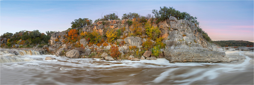 Heavy rains caused the Pedernales River to swell to giant proportions in mid-November. I was perched on a rock to take this panorama comprised of several images stitched together. It is a satisfying view as I had to cross several precarious water filled gulleys using my tripod as a guide to test the depth of the water. After scramping up about 10 feet to reach this top of this rock, I took in the sights. Several folks saw me up here, but after looking at what they had to do to reach my position, they turned away :-) <br /> <br /> With a backdrop of Texas colors of Autumn and waning light in the northern sky, I was pleased wiht this panorama.
