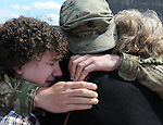 A tearful reunion as Specialist Ryan Ward of Glastonbury, cries into the arms of his sister Kelly, left,  of Boston, and his mother Susan, of Glastonbury Conn.  as members of the Connecticut National Guard's 143rd Military Police Company out of West Hartford, returned home Wednesday, June 5, 2013, to the Air National Guard base in East Granby following a deployment in Afghanistan.  (AP Photo /  Journal Inquirer, Jim Michaud)