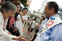 "Hiroshi Yamada of The Spirit of Japan (Nippon Soshinto) which is right Wing/Nationalist) political party with ties to the  Shinzo Abe-led bipartisan group of lawmakers, ""Sosei-Nippon,"" and the Sunrise Party of Japan, led by Takeo Hiranuma, campaigning in Hachiko Square in Shibuya, Tokyo, Japan June 26th 2010"