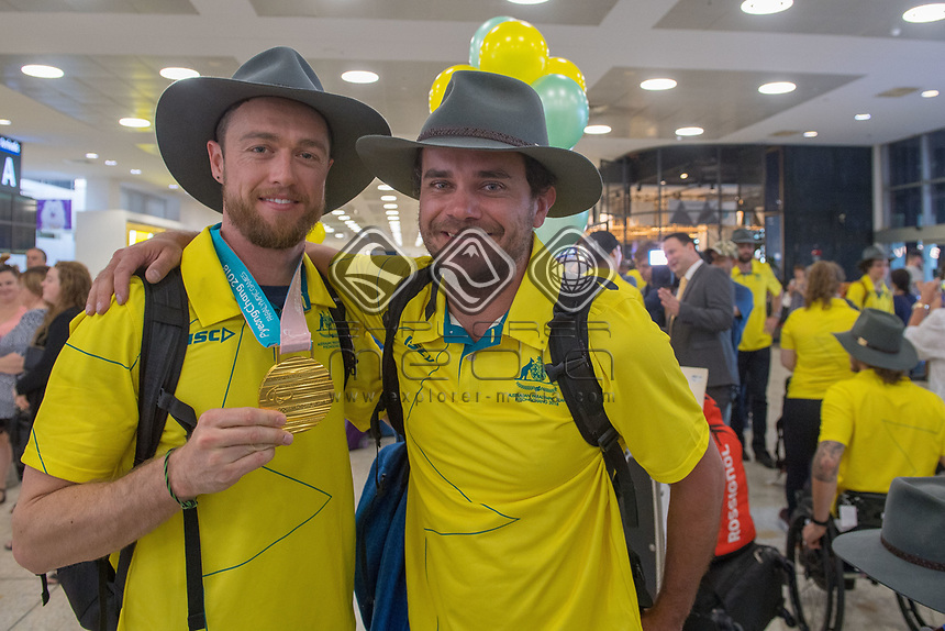 Welcome home / Simon Patmore with Lucas Prem<br /> PyeongChang 2018 Paralympic Games<br /> Australian Paralympic Committee<br /> Sydney International Airport<br /> PyeongChang South Korea<br /> Tuesday March 20th 2018<br /> &copy; Sport the library / Jeff Crow