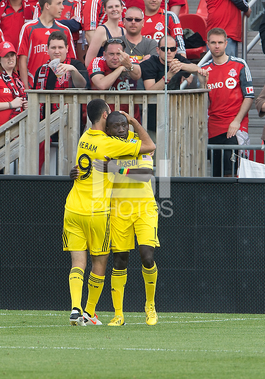 18 May 2013: Columbus Crew foward/midfielder Dominic Oduro #11celebrates his goal with Columbus Crew forward Justin Meram #9 during an MLS game between the Columbus Crew and Toronto FC at BMO Field in Toronto, Ontario Canada..The Columbus Crew won 1-0...